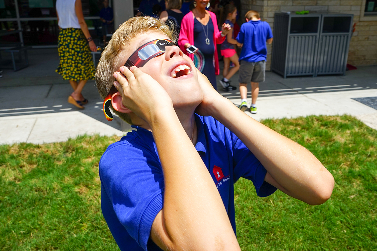 Student Watching Eclipse with Big Smile