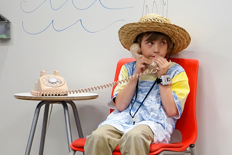 student dressed as farmer talking on phone
